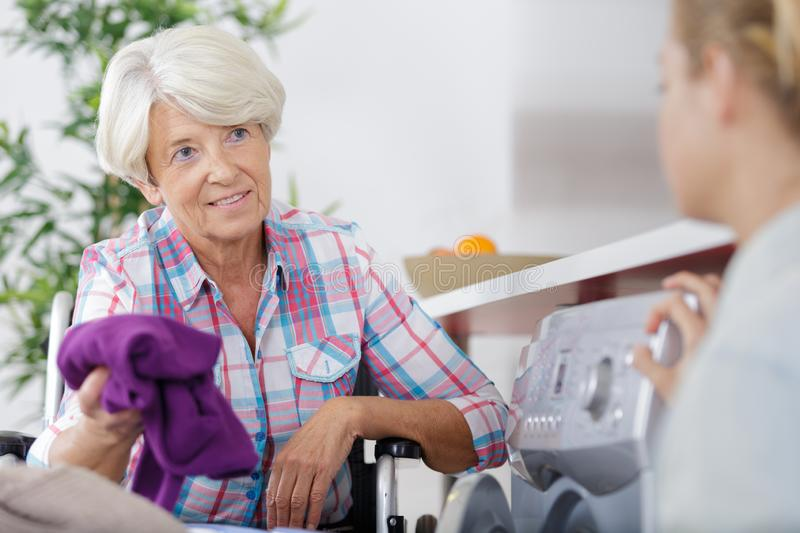 Elderly woman talking to home helper royalty free stock photo