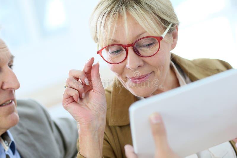 Elderly woman trying on eyeglasses. Senior women trying new eyeglasses on stock photos