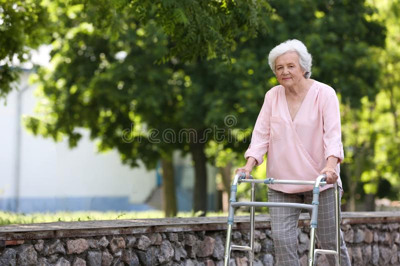 Elderly woman with walking frame . Medical help royalty free stock photo