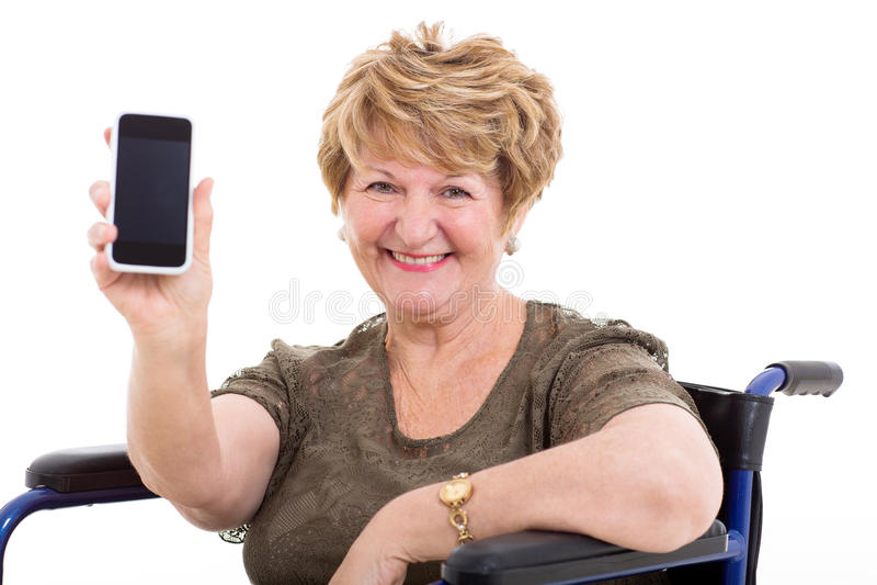 Elderly woman wheelchair smart phone royalty free stock photography