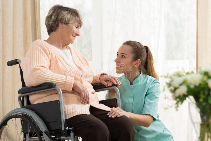 Elderly woman on wheelchair royalty free stock images