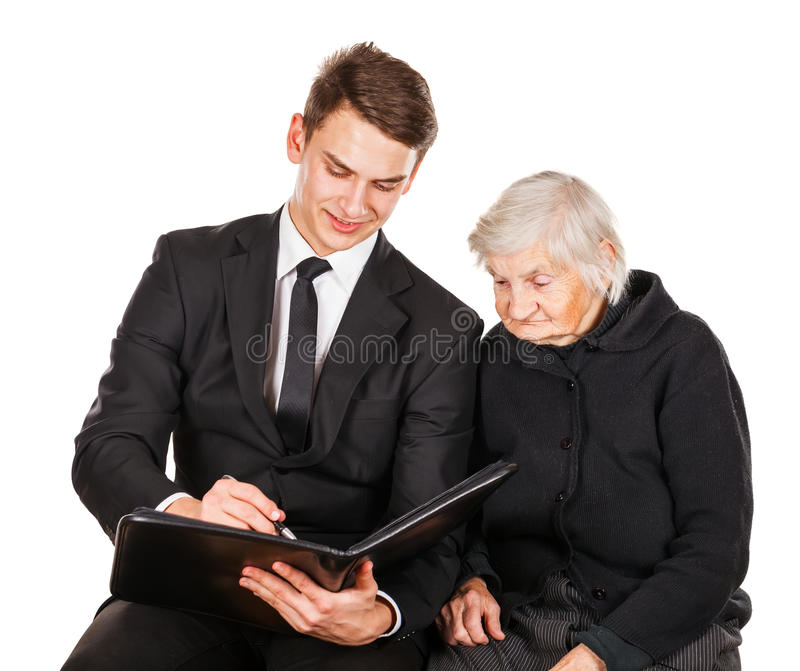 Elderly woman and young businessman stock images
