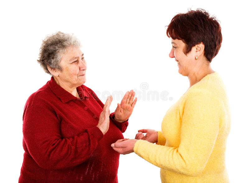 Elderly woman and young caregiver. Photo of young caregiver holding elderly women hands royalty free stock images