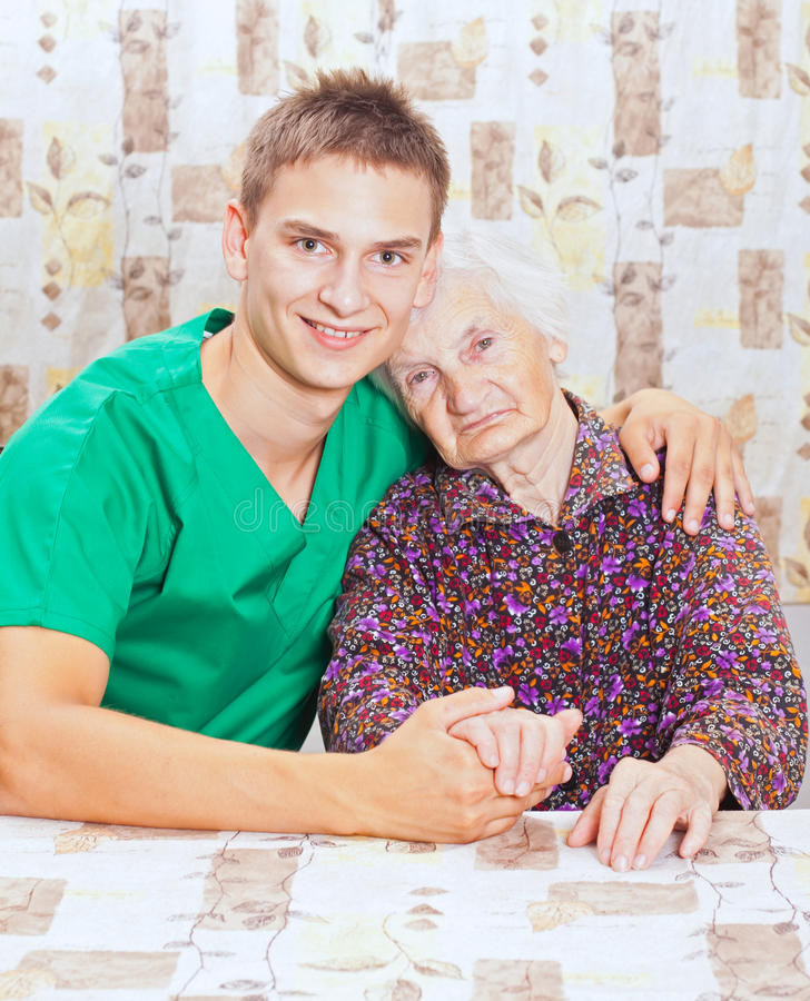 Elderly Woman With The Young Smileing Doctor Royalty Free Stock Photos