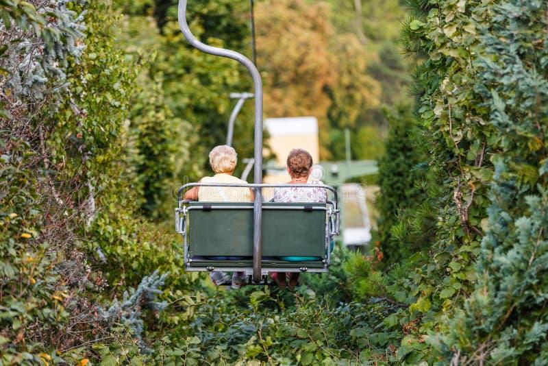 Elderly women on chairlift stock photos