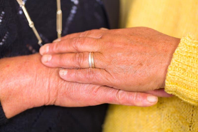 Elderly women hands. Close up photo of elderly women hands stock image