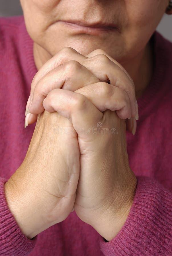 An elderly women having a peaceful moment royalty free stock photos