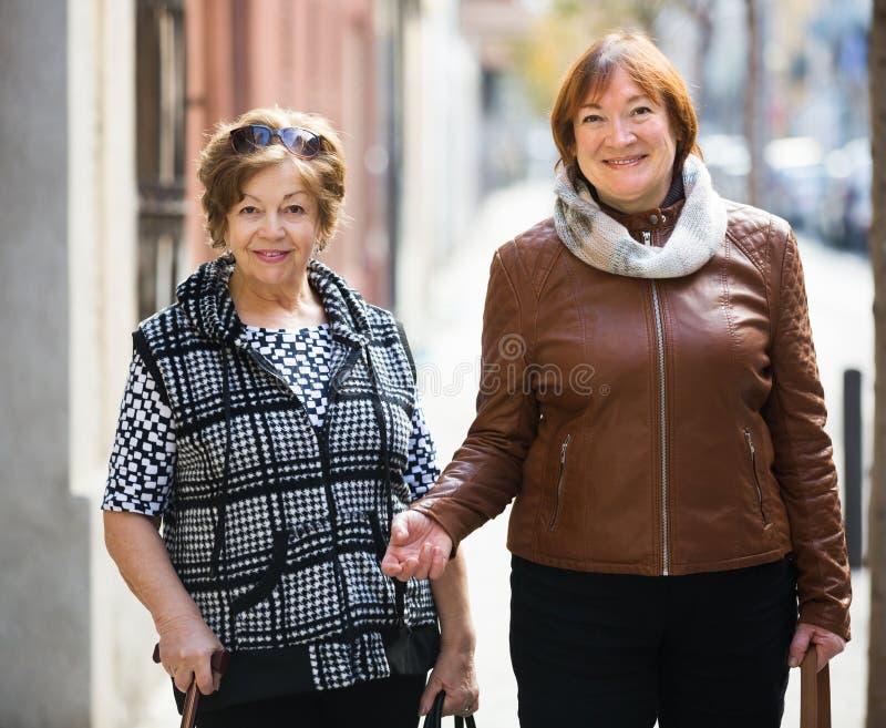 Elderly women having a walk royalty free stock photography