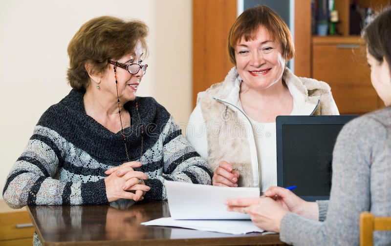 Elderly women making will at public notary office. And smiling royalty free stock photos