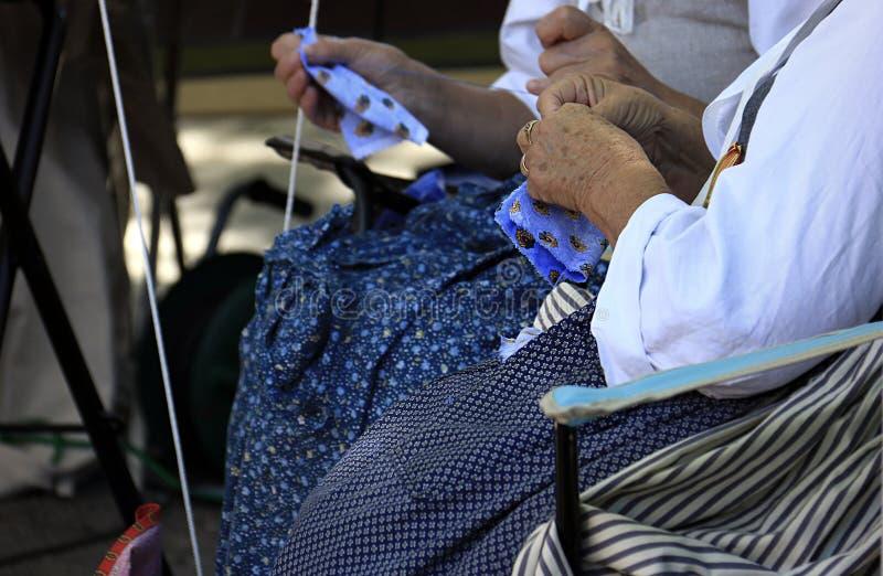 Elderly Women Sewing royalty free stock photo