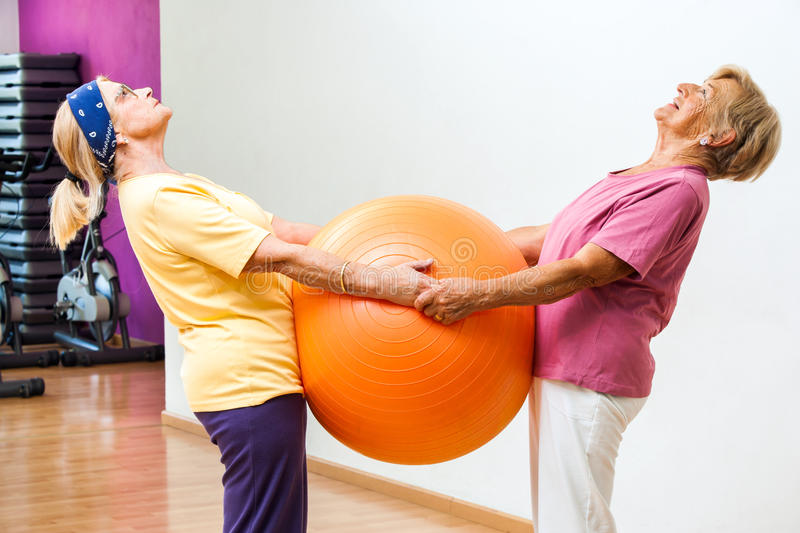 Elderly women stretching with gym ball. royalty free stock photos