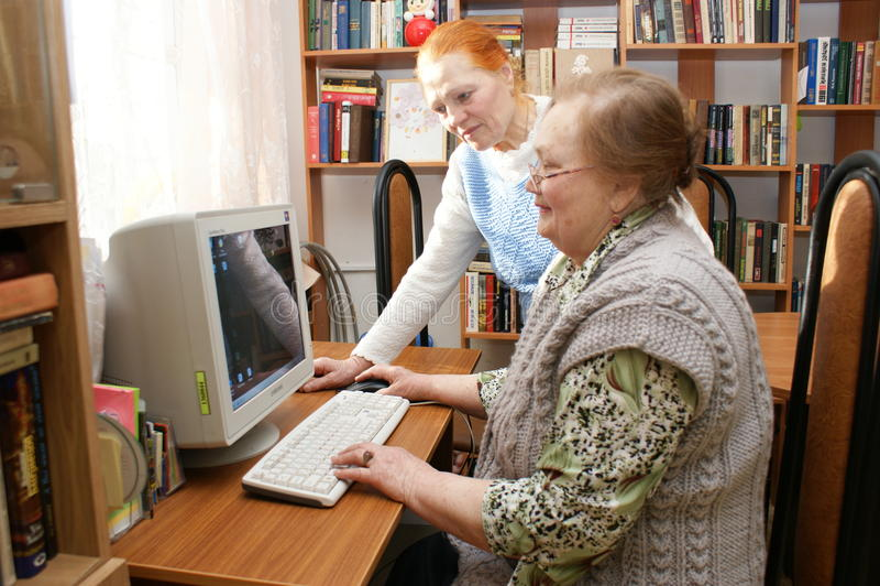 Elderly women study the computer royalty free stock photo