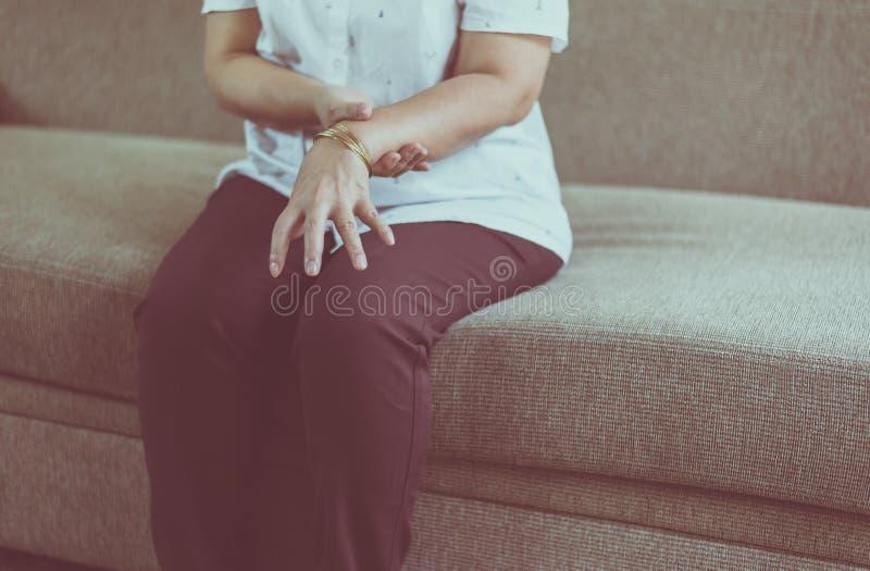 Elderly woman suffering with parkinson`s disease symptoms on hands. Elderly women suffering with parkinson`s disease symptoms on hands stock photos