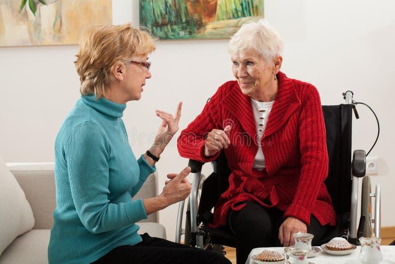 Elderly women talking stock photos