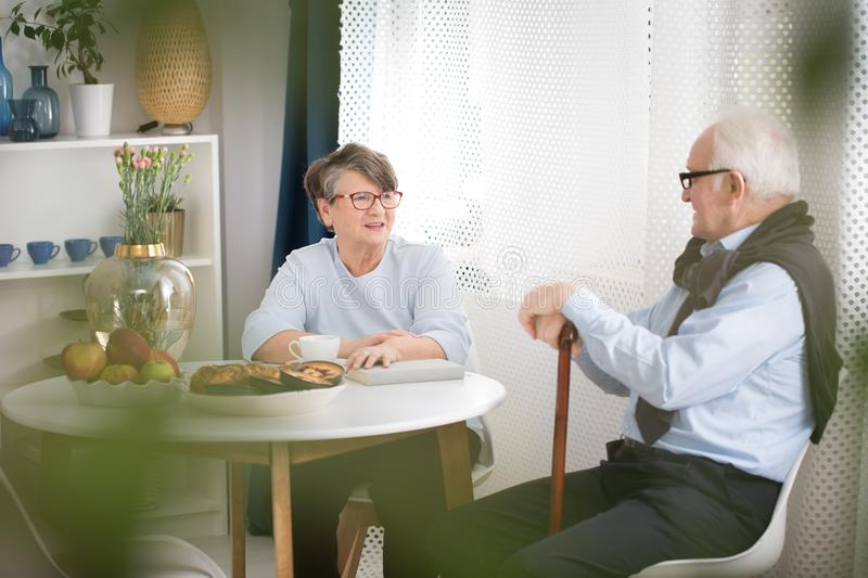 Elderly woman talking to grandfather royalty free stock photography