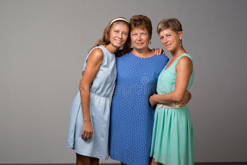 Elderly woman with two adult daughters royalty free stock image