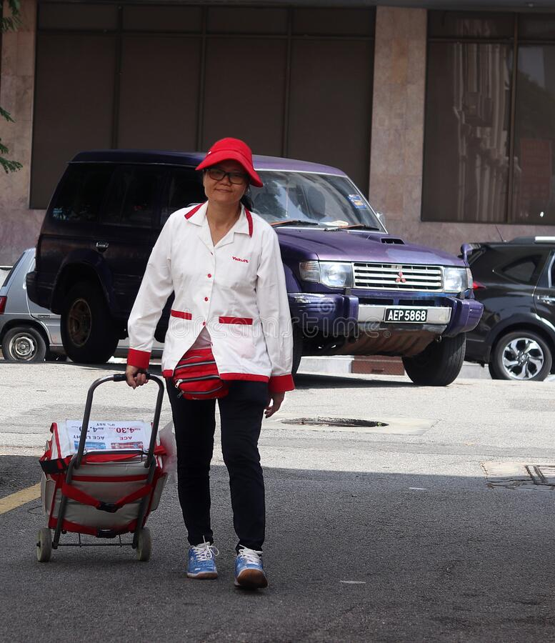 Free Elderly Yakult Lady Walking Down The Street Stock Photography - 171426332