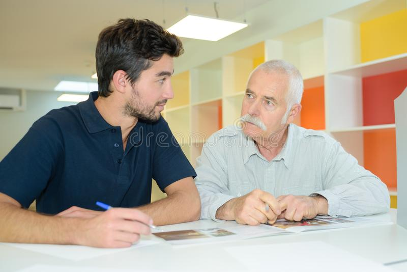 Eldery father granfather and son working together royalty free stock photo