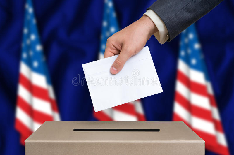 Elección en los Estados Unidos de América - votando en la urna foto de archivo