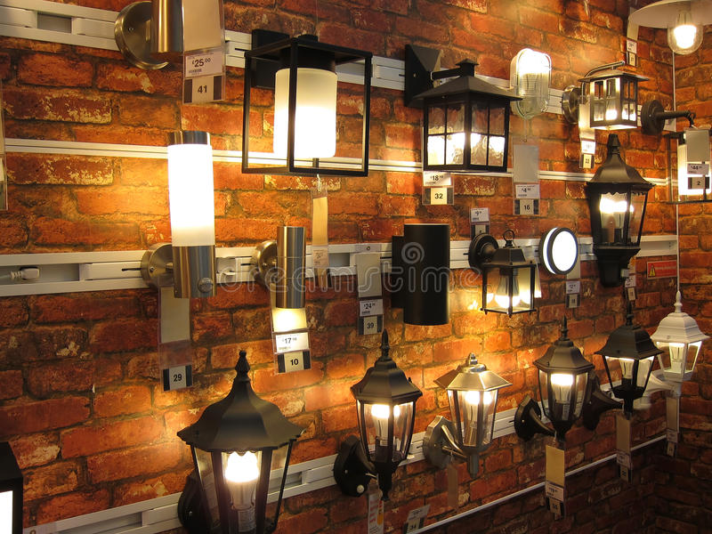 Electic wall lamp display in a lighting store. stock photo