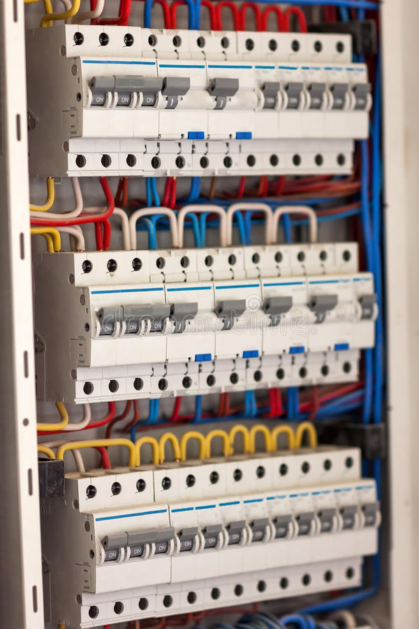 Electical distribution fuseboard. Electrical supplies. Electrical panel at a assembly line factory. Controls and switches. stock photography