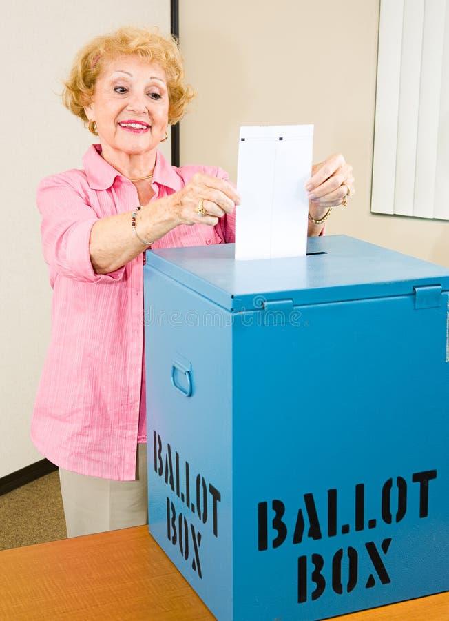 Election - Senior Woman Casts Ballot royalty free stock photography