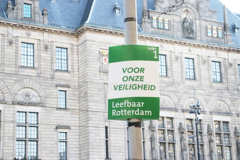 Election sign of the Leefbaar party with the city hall on background on the Coolsingel in Rotterdam the Netherlands. royalty free stock photography