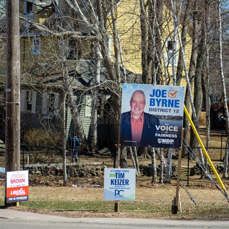Election signs of NDP PEI, PEI PC Party, and Liberal PEI for the provincial election 2019 in Charlottetown royalty free stock image