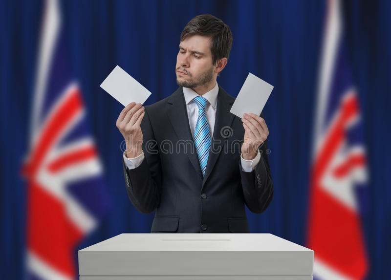 Election in United Kingdom. Undecided voter is making decision royalty free stock image