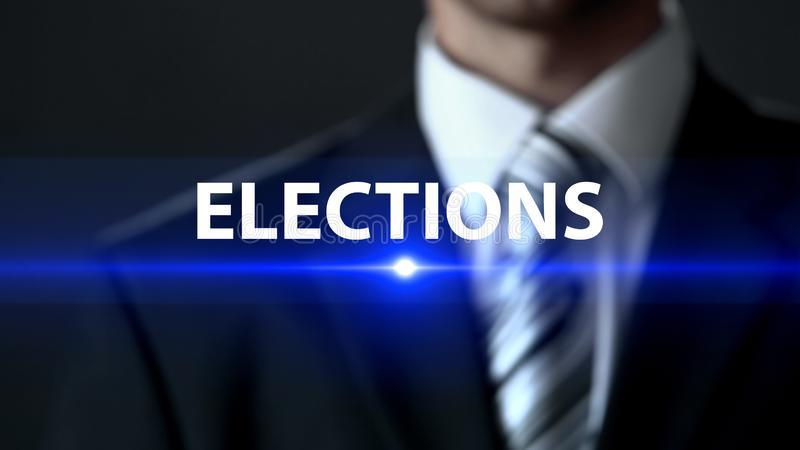 Elections, politician in suit standing in front of screen, political campaign. Stock photo stock photos