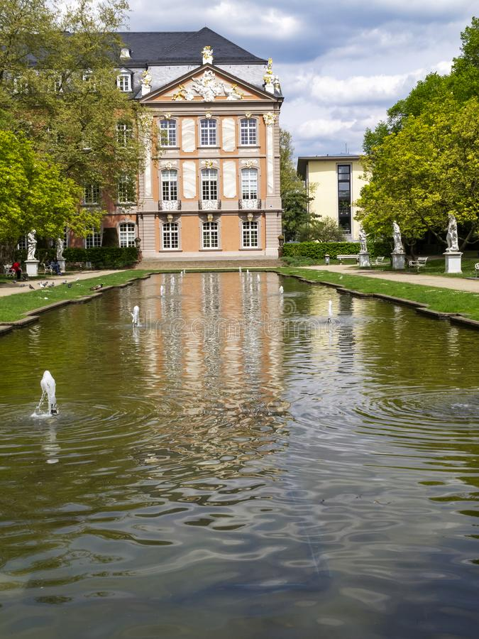 Electoral Palace with pond in Trier, Germany. Electoral Palace with a pond in Trier, the oldest German city on a sunny April day stock photography