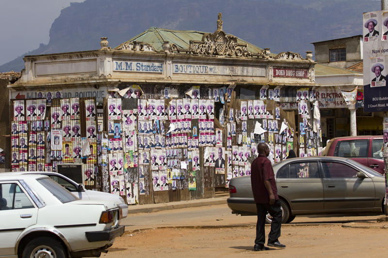 Electoral posters on an abandoned colonial boutique in Eastern Uganda stock images