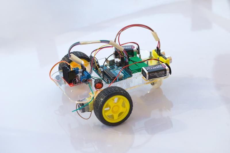 Electornic car robot kit module made from micro controller open source circuit hardware for kid education future royalty free stock image