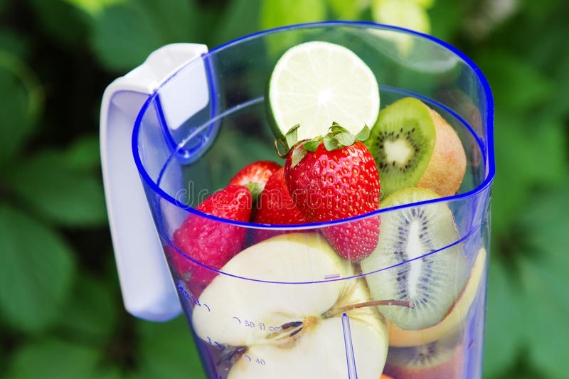 Electric blender with fruits in it royalty free stock photos