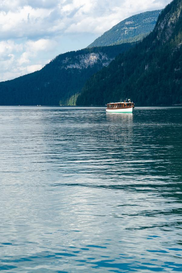 Electric boat on  Koenigssee lake in Berchtesgaden. Electric boat on  Koenigssee lake in berchtesgaden in Bavaria Alps stock image