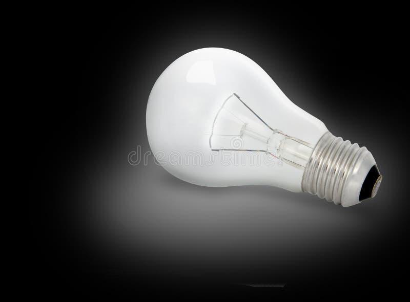 Electric Bulb. On black background (illuminate on head royalty free stock photography