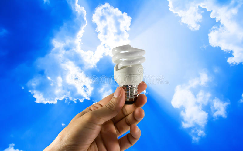 Electric bulb in hand stock photos