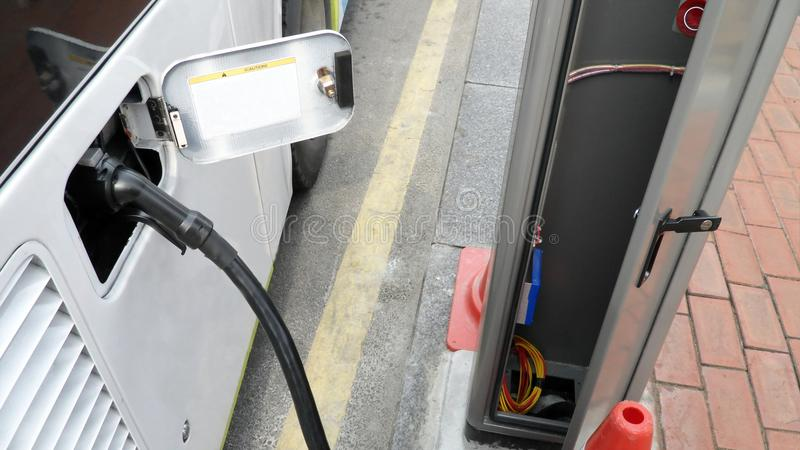 Electric bus charging battery from power generated point on street in south Korea royalty free stock photo
