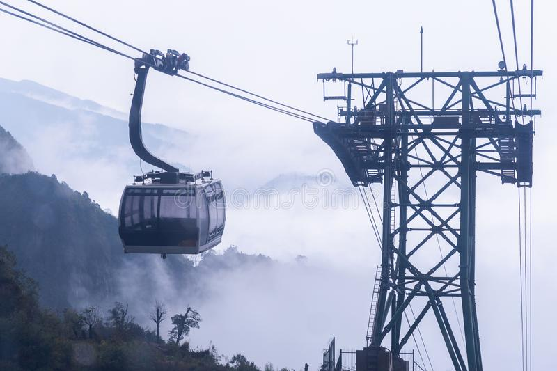 Electric cable car go to Fansipan mountain peak the highest mountain in Indochina, At 3,143 metres in Sapa, Vietnam.  royalty free stock photos
