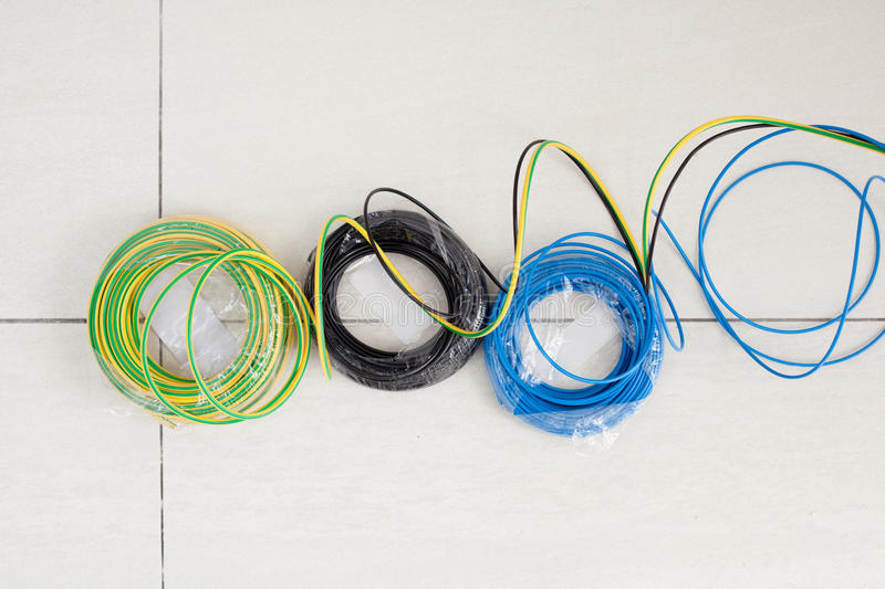 Electric Cable Coil In Three Colors Black Blue And Earth Stock Photo