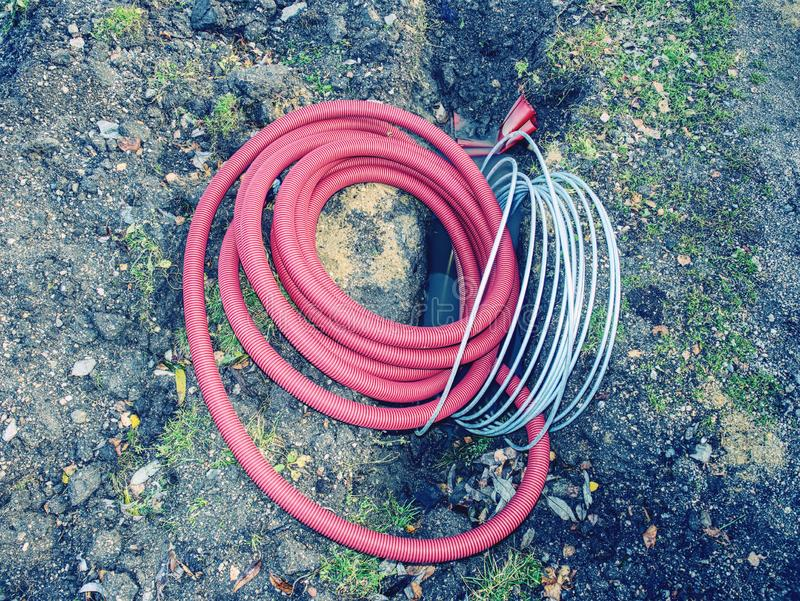 Electric cable in the flexible safety pipe in pit stock photo