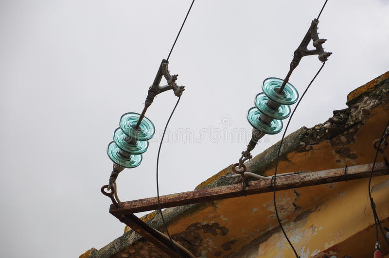 Electric cables. Near the house stock image
