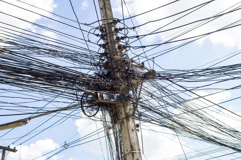 Electric cables tangle on electric pole. S stock photo