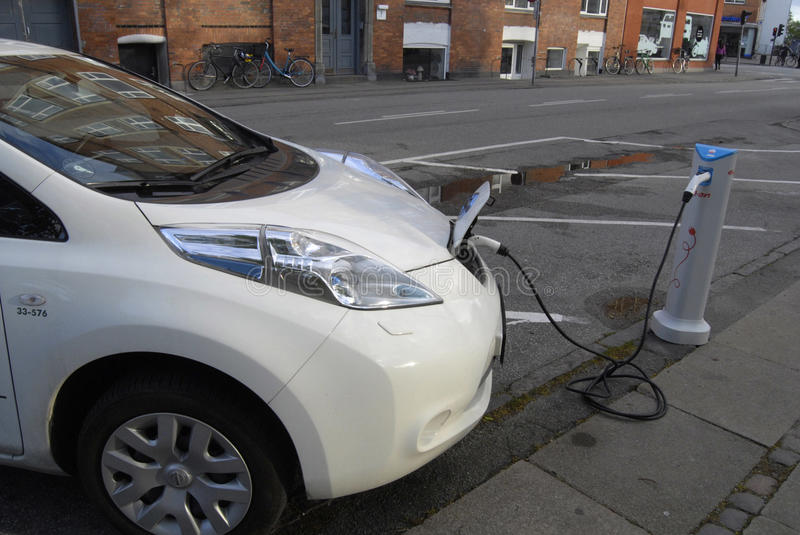 ELECTRIC CAR IS BEING CHARGE stock photos