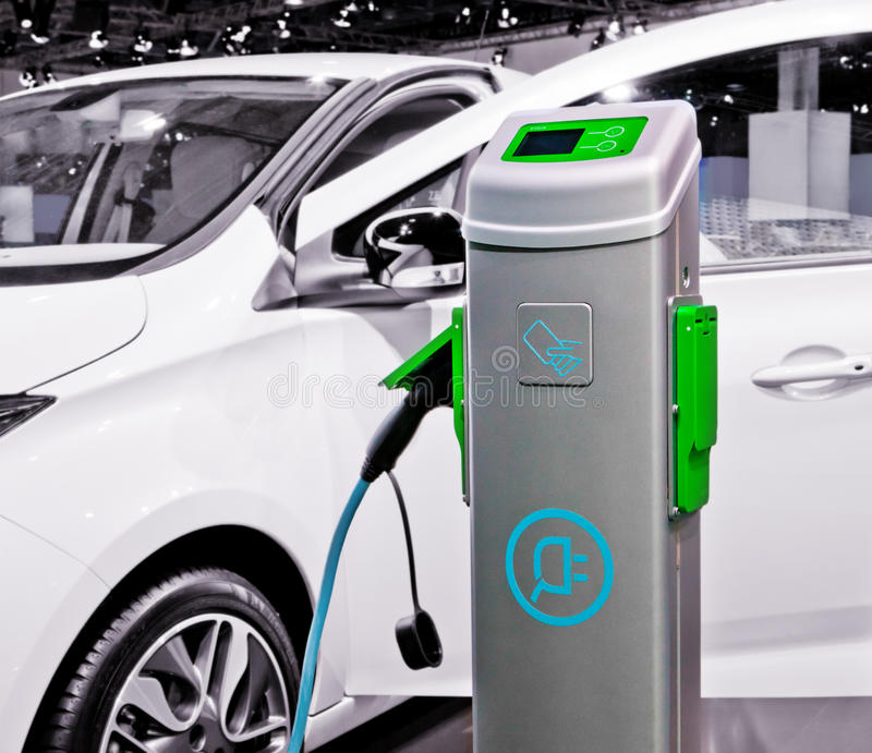Electric car being charged. royalty free stock images