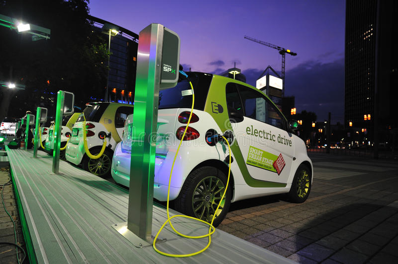 Electric cars powering at charging station stock photo
