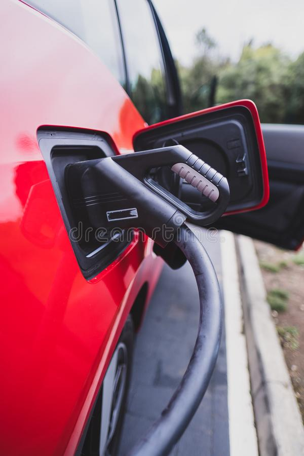Electric car charging on CCS Rapid Quick DC Charger stock photo
