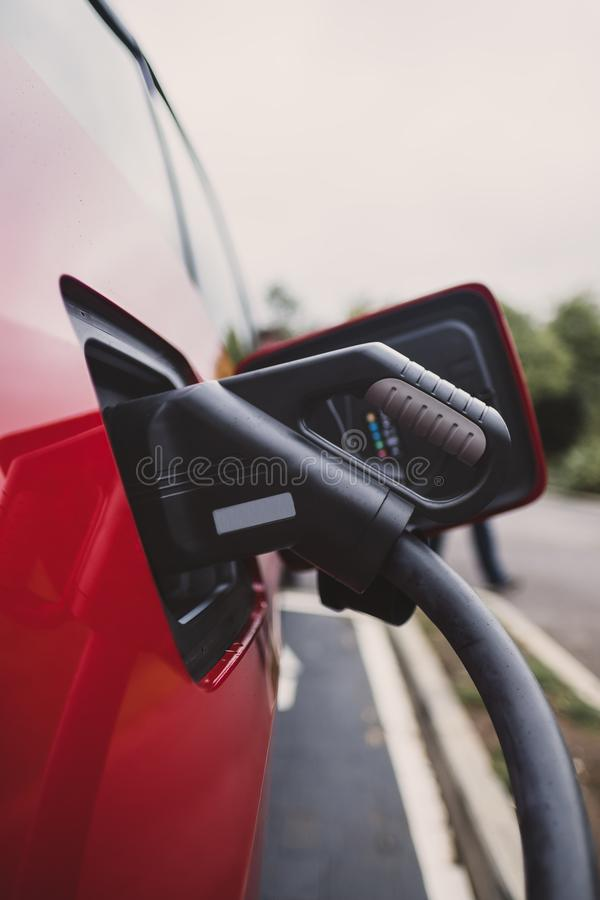Electric car charging on CCS Rapid Quick DC Charger royalty free stock photos