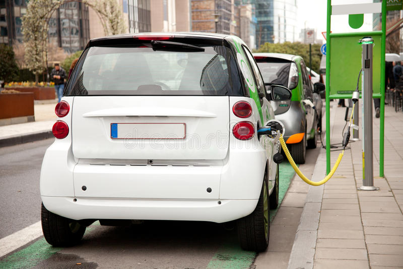 Electric car. Is charging at a charge station in the street royalty free stock photography