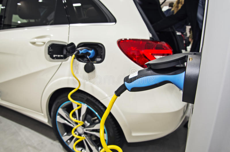 Electric car at the charging station royalty free stock photo